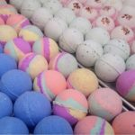 All natural bath bombs in Burlington with colourful styles like blue, green, pink purple, assembled in a neat row.